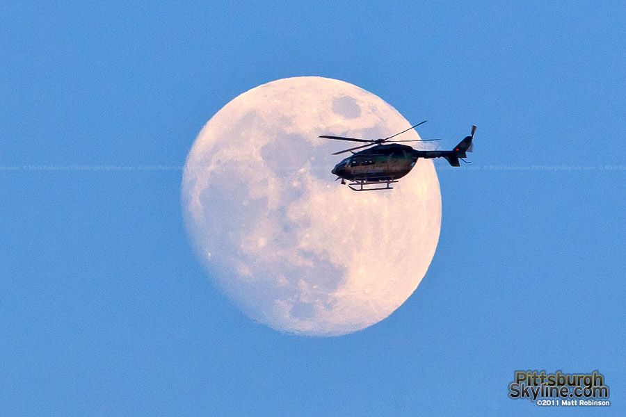 Allegheny General Life flight helicopter passes in front of the moon