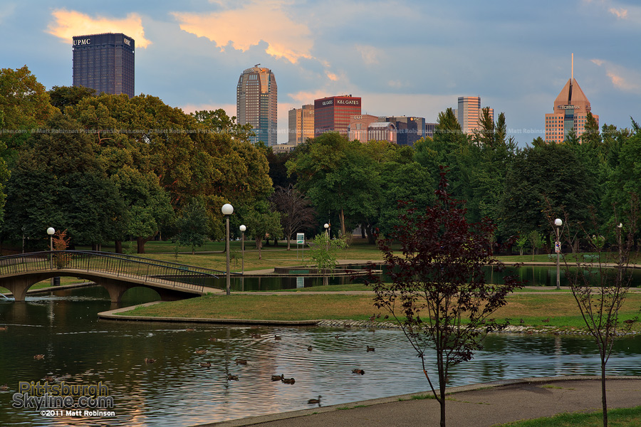 The Pittsburgh Skyline rises above Lake Elizabeth at West Park on the North Side