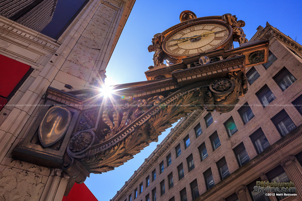 Sunlight glints through Pittsburgh's Kaufmann's clock