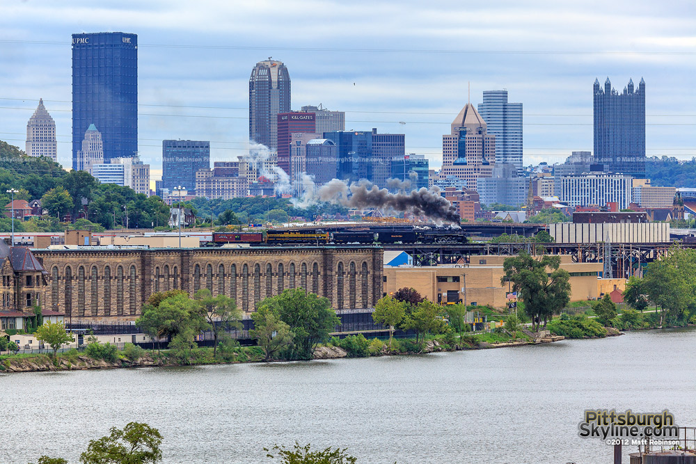 Nickel Plate Road 765 crosses the OC Bridge with the downtown Pittsburgh skyline looming