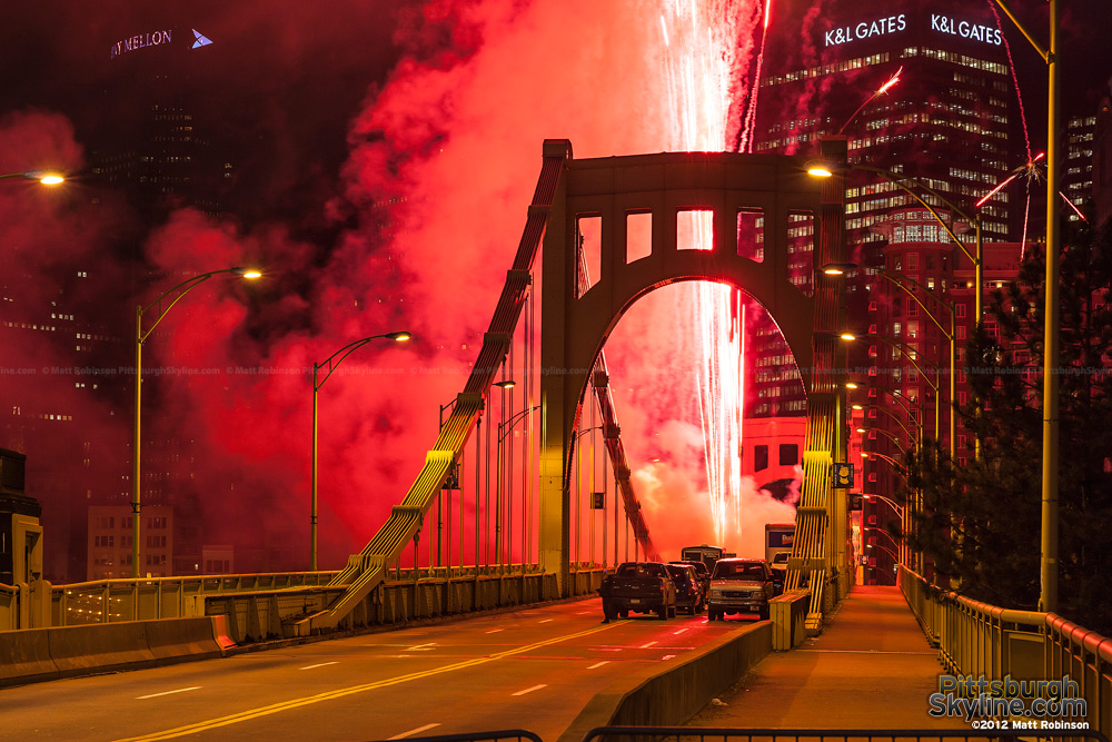 Red pyrotechnics blast of the Andy Warhol Bridge in Pittsburgh
