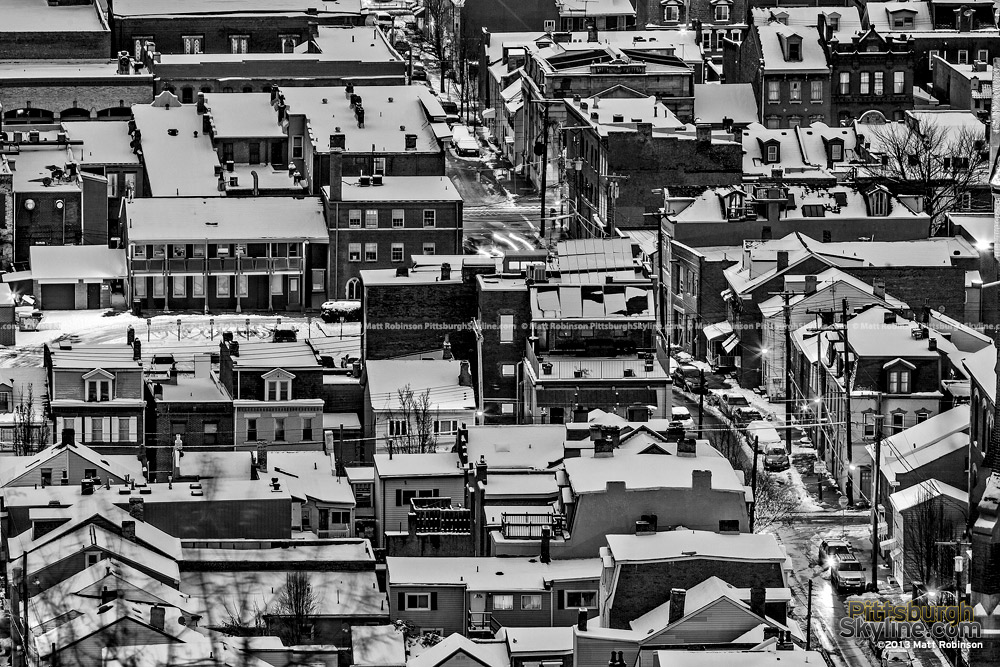 Black and white Snow covers Pittsburgh South Side Rooftops