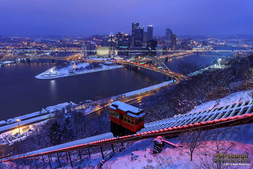 Pittsburgh skyline at night with snow and Duquesne Incline