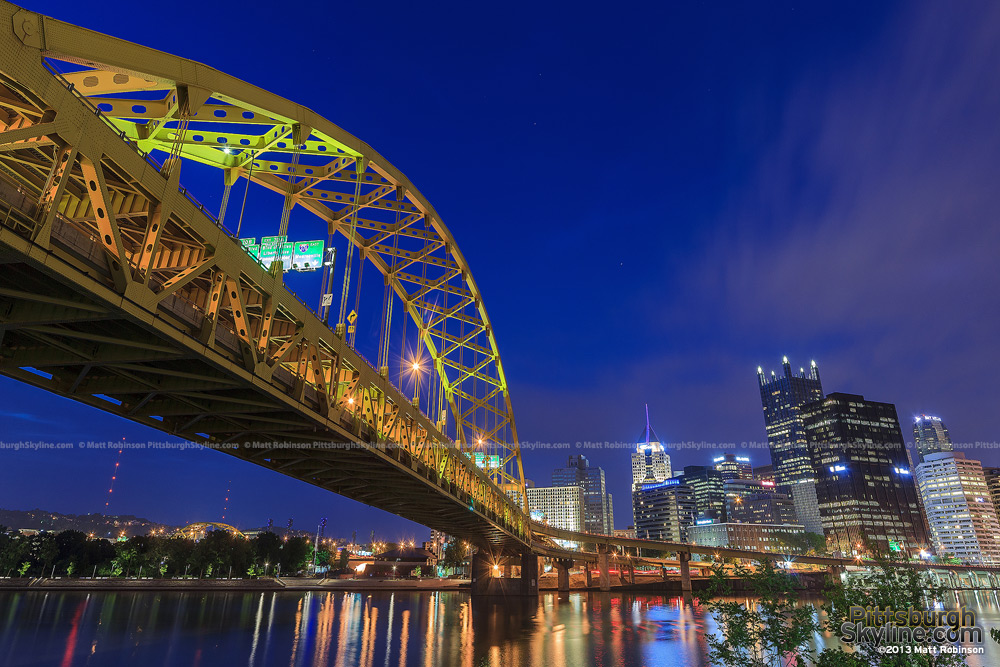 Pittsburgh's Fort Pitt Bridge leads into the Golden Triangle at night