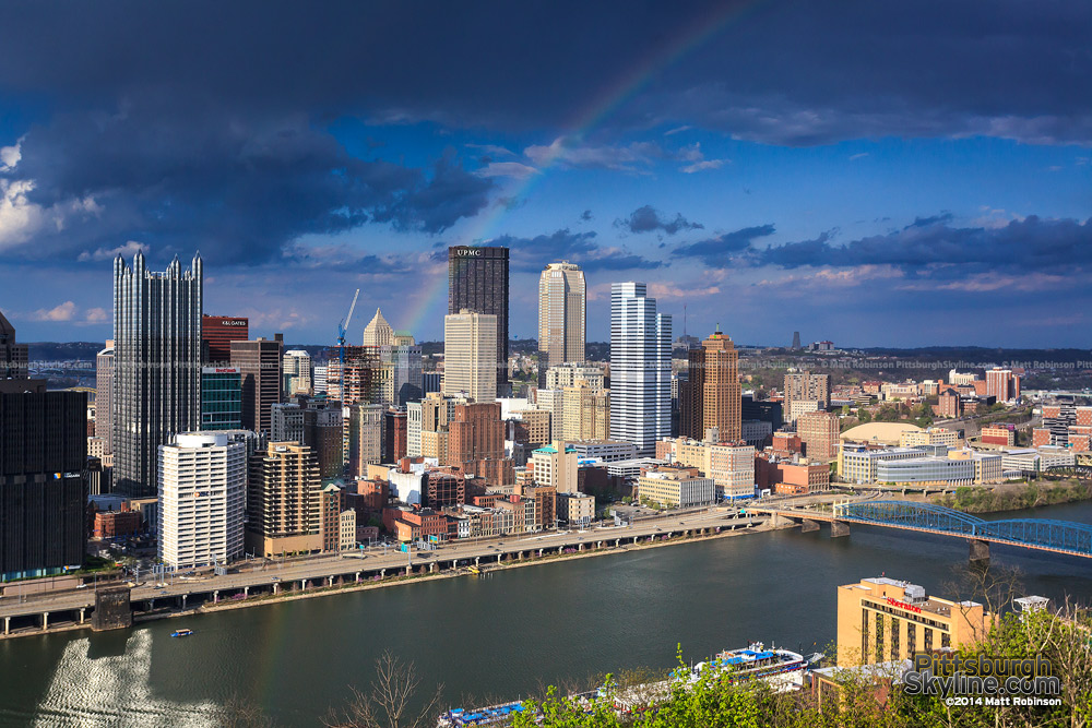 A rainbow lands over the Pittsburgh skyline