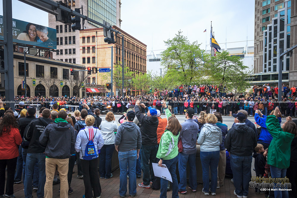 Spectators along Liberty Avenue watch runners during the Pittsburgh Marathon