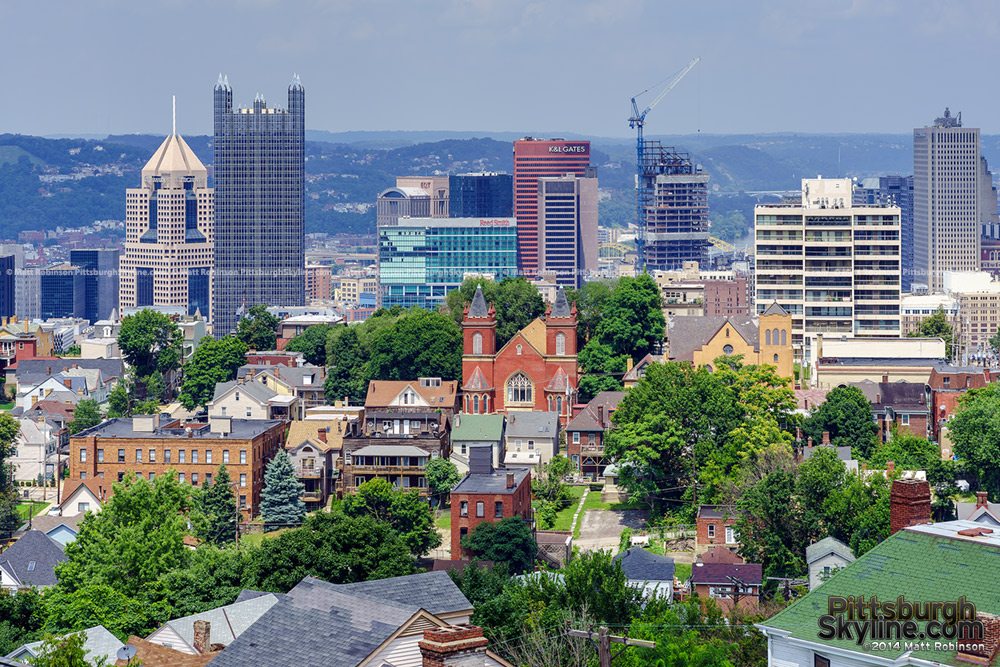 Pittsburgh skyscrapers rise over the surrounding neighborhood of Mt. Washington from the roof of the Prospect School
