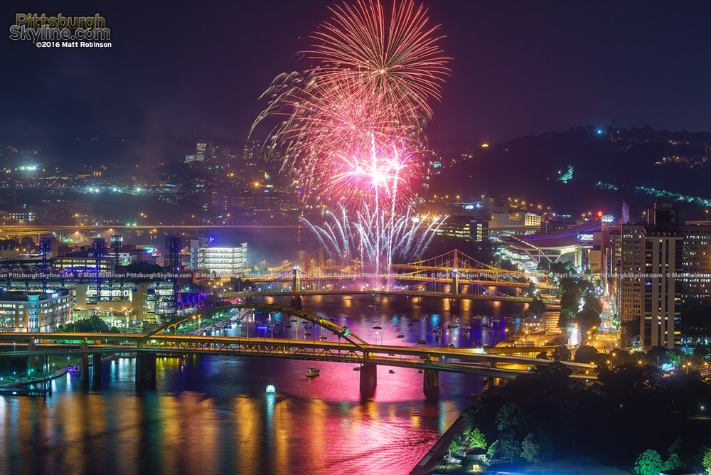 Red Fireworks explode over Pittsburgh Bridges