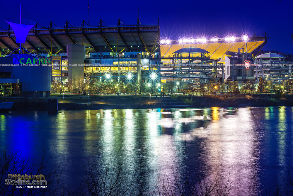 Heinz Field lit after a game with reflection in the Ohio River