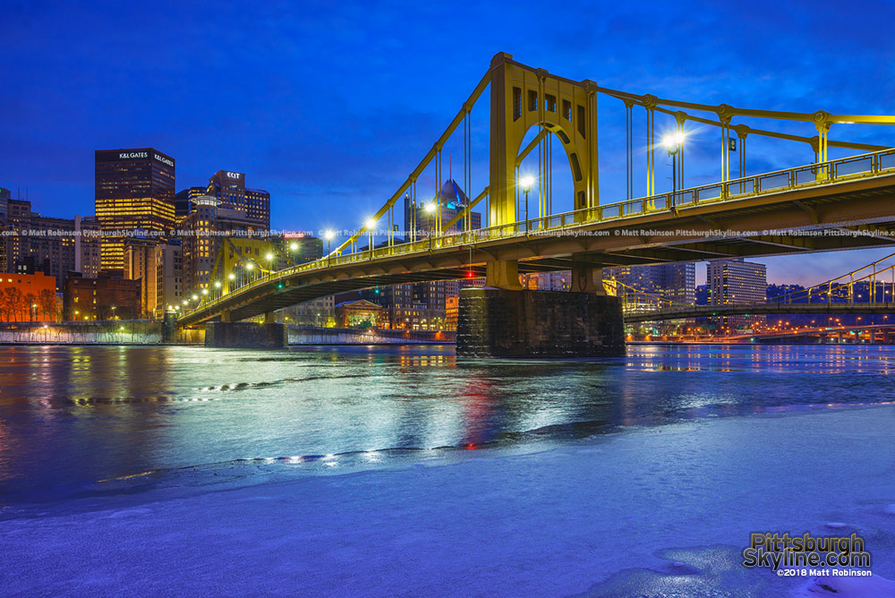 Icy covered Allegheny River with renovated Andy Warhol Bridge 2018