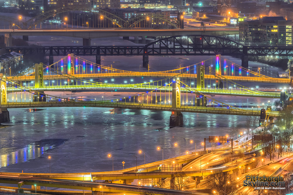 The tree sisters bridges over the icy Allegheny River
